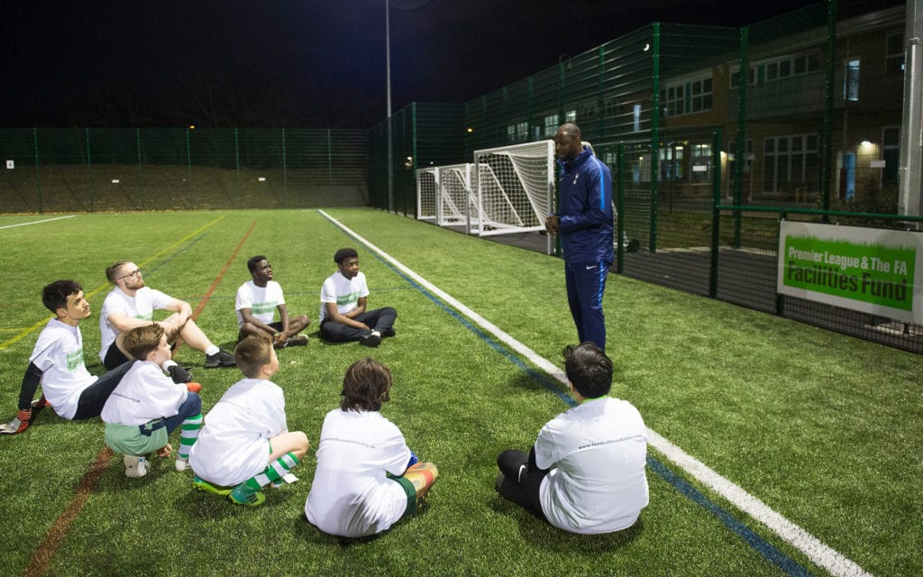 Ledley King talks to children at the launch of 3G Sports Pitch