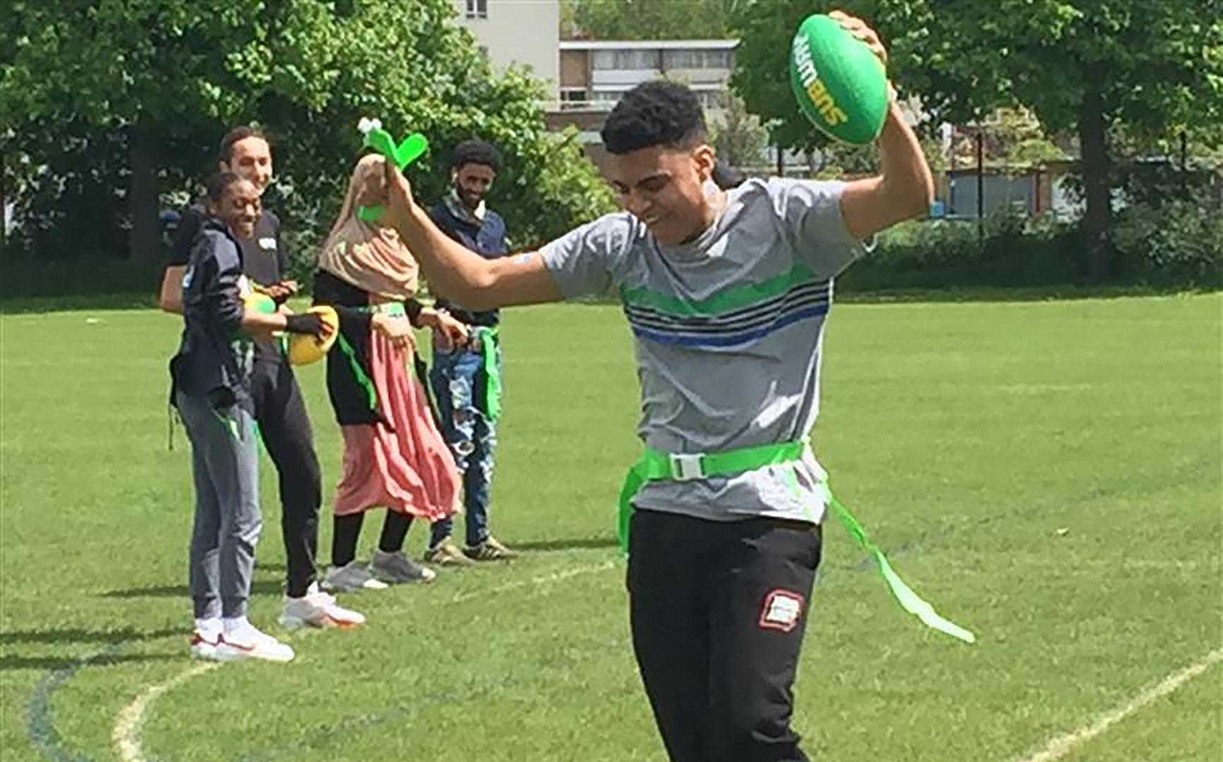 Students playing american football